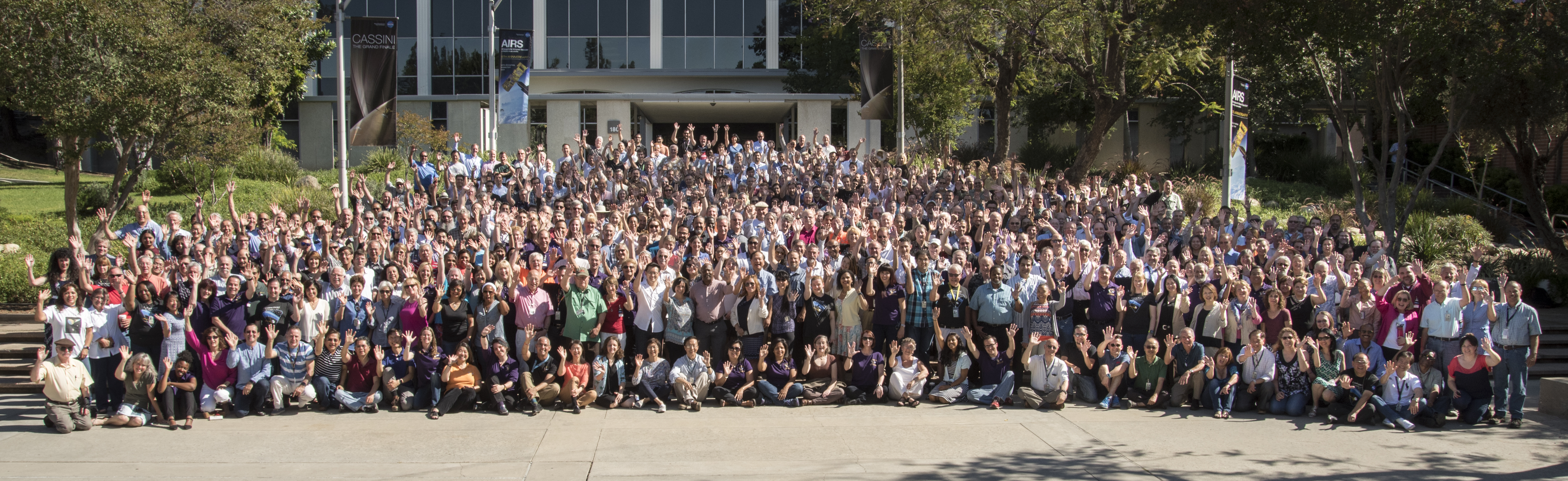 Cassini team members wave at JPL