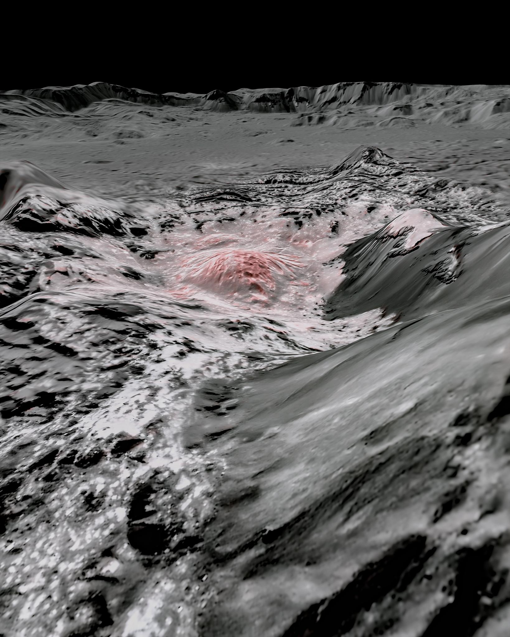 Steep hills in the basin of a crater are shown in black and white with a speckled trail of white leading to a white and pink mound at the center of the image.