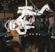 astronauts using the  Precision Air Bearing Platform at Johnson Space Center