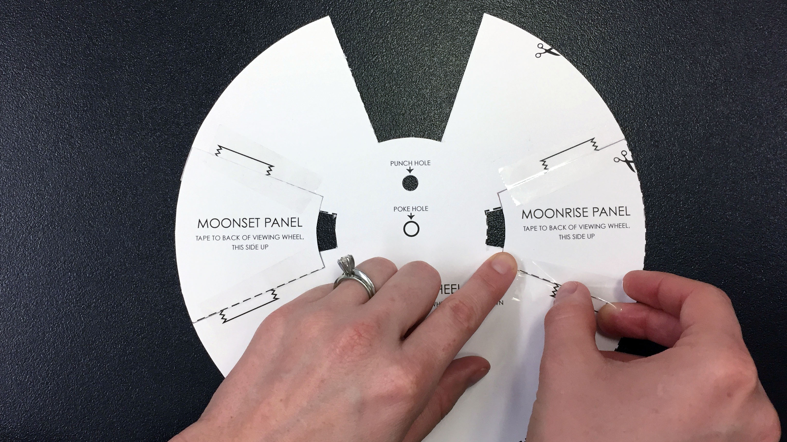 Tapping the Moonrise and Moonset panels to the back of the Viewing Wheel.
