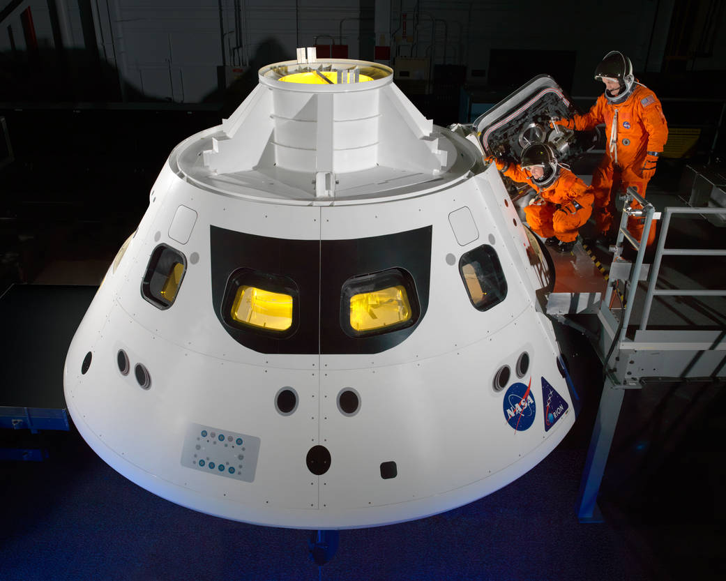 Orion crew members step into the capsule