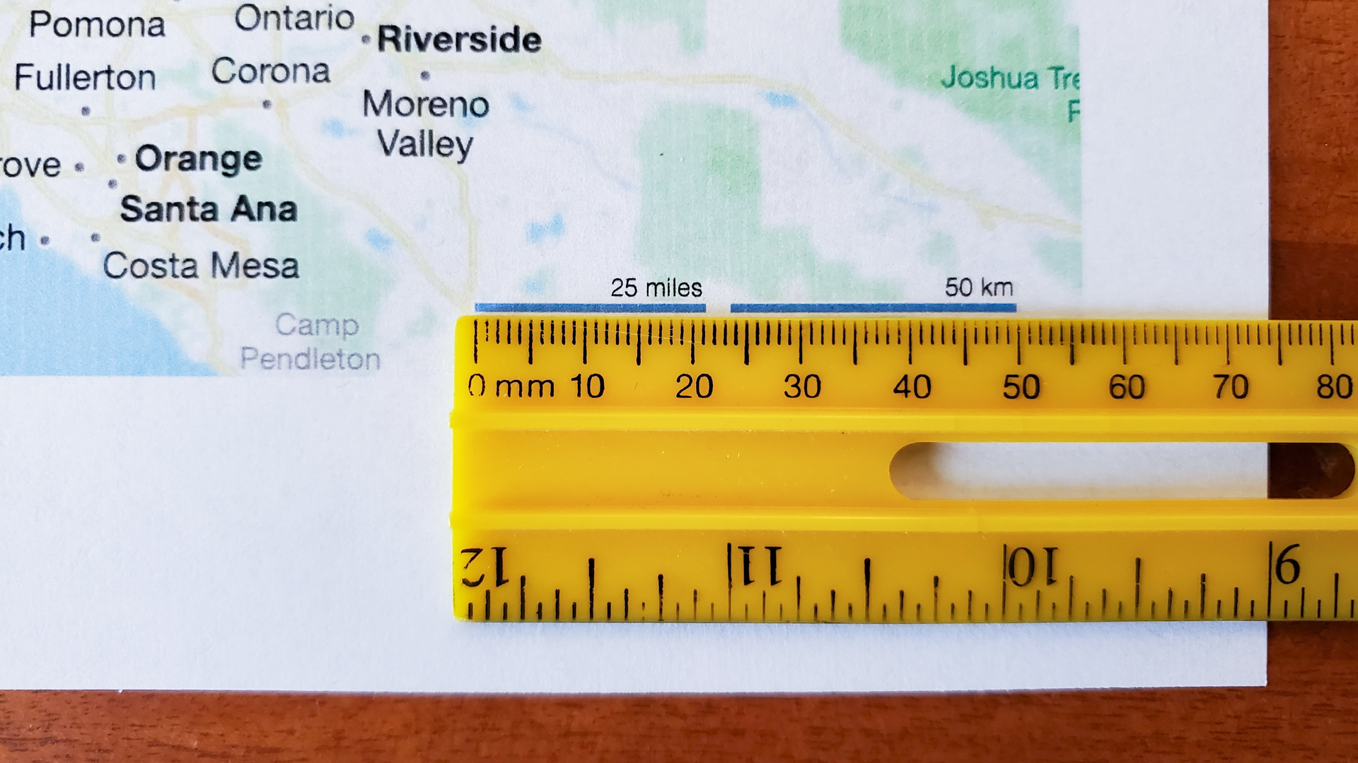 A ruler is shown beside the scale on a printed out map