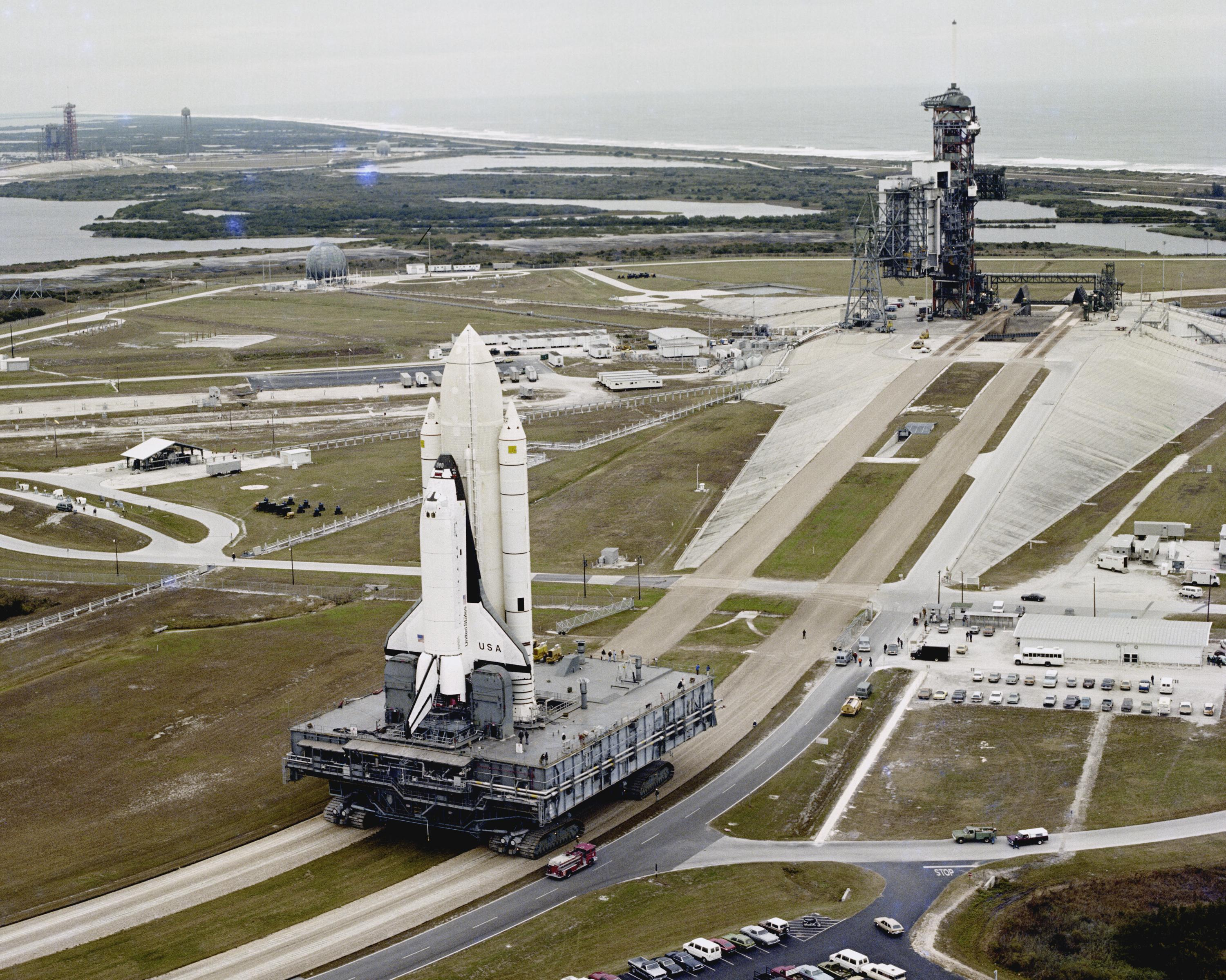 A NASA crawler-transporter moves a shuttle to the launchpad