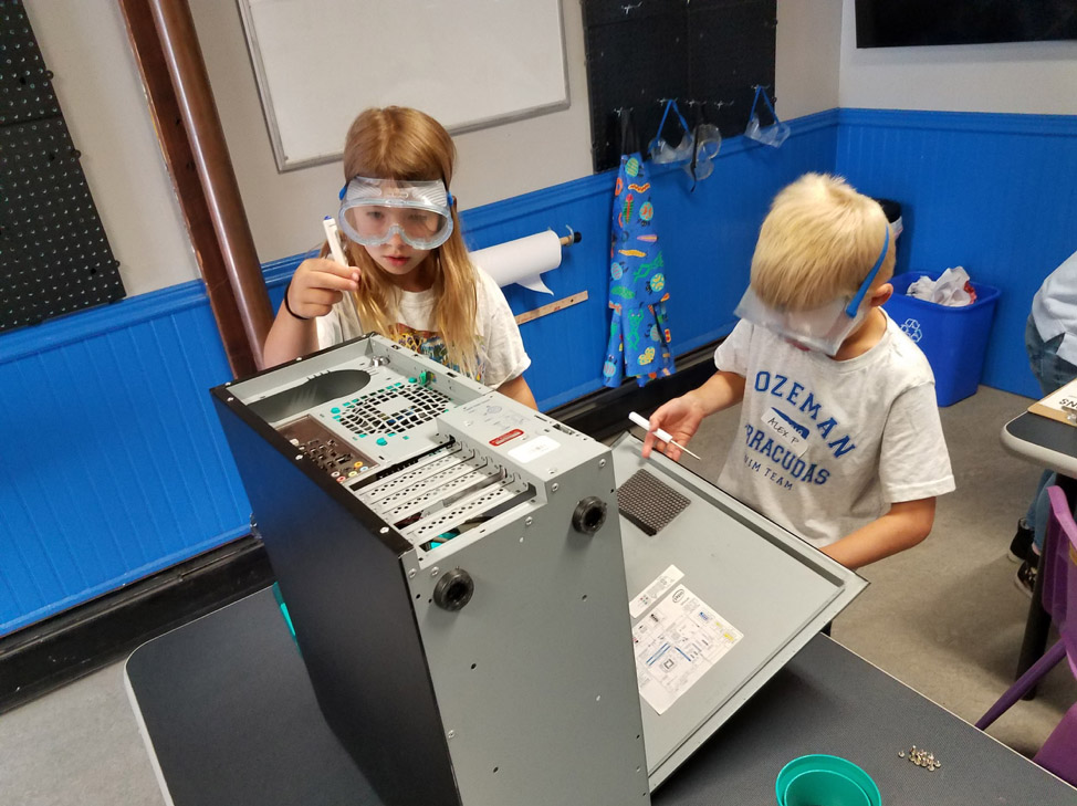 Two kids explore the STEAMlab at the Children's Museum of Bozeman