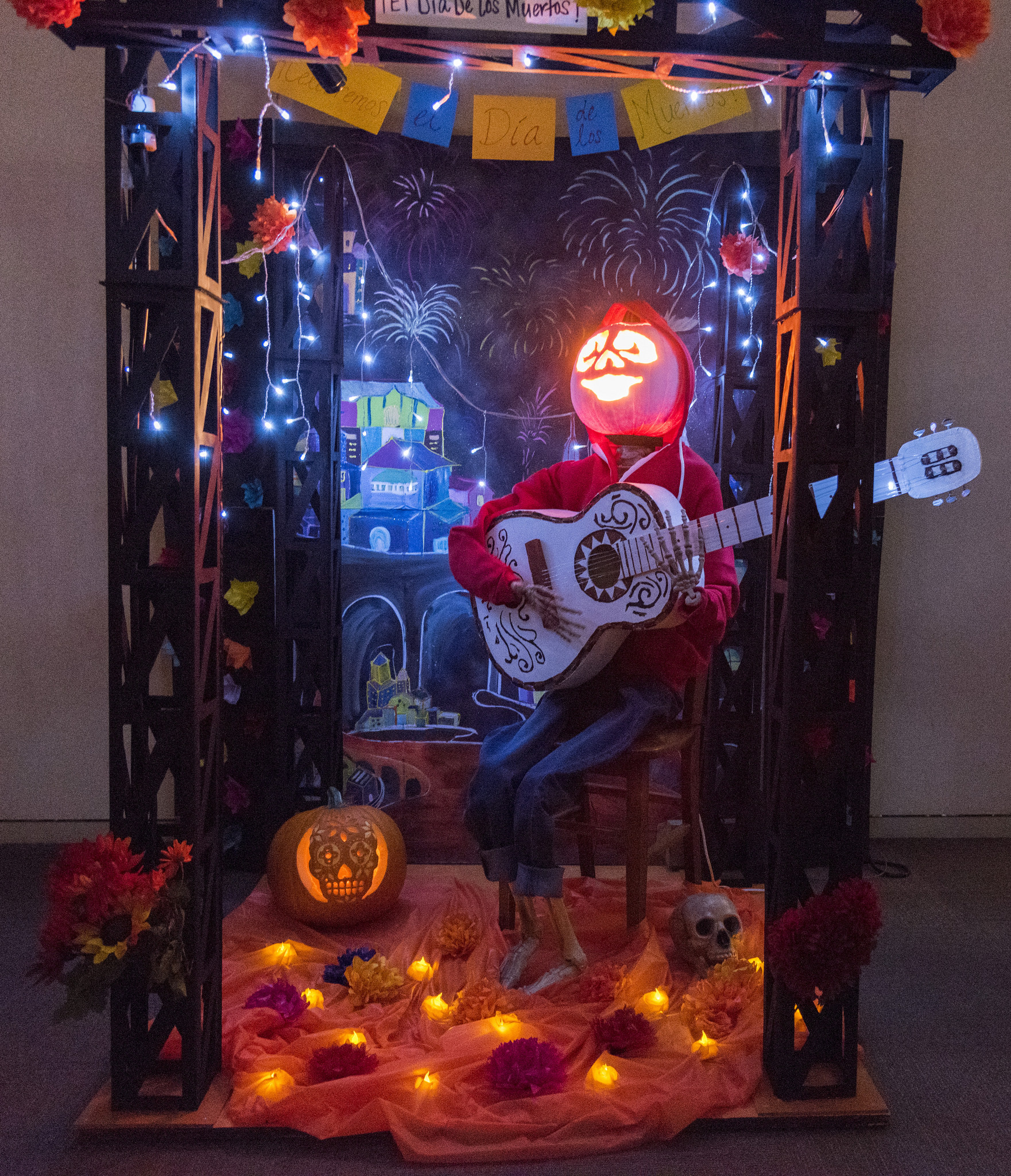 Pumpkin modeled after Miguel from the movie 'Coco' strumming a guitar