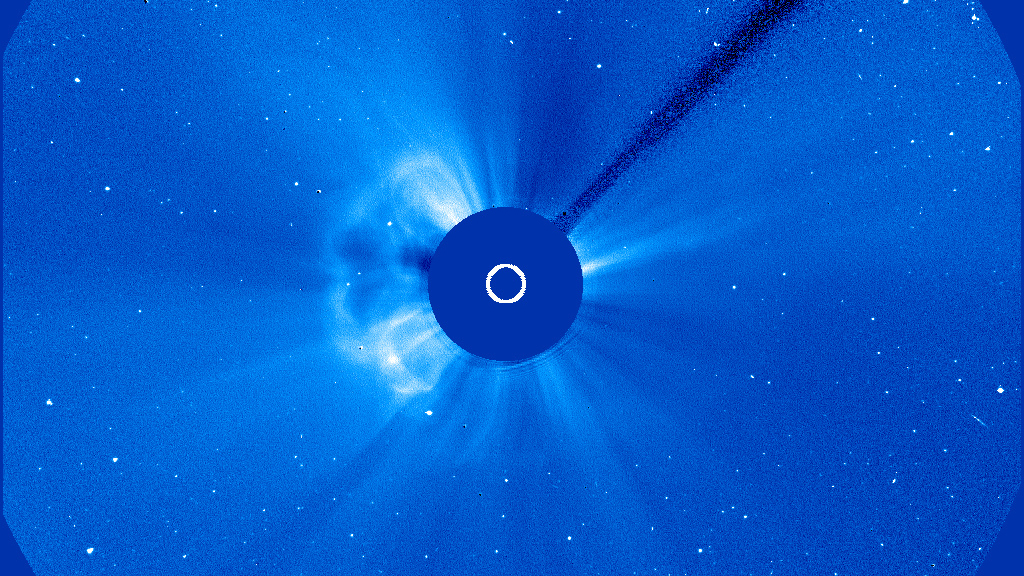 Wispy solar flares from the Sun can be seen jutting out from a solid central circle.