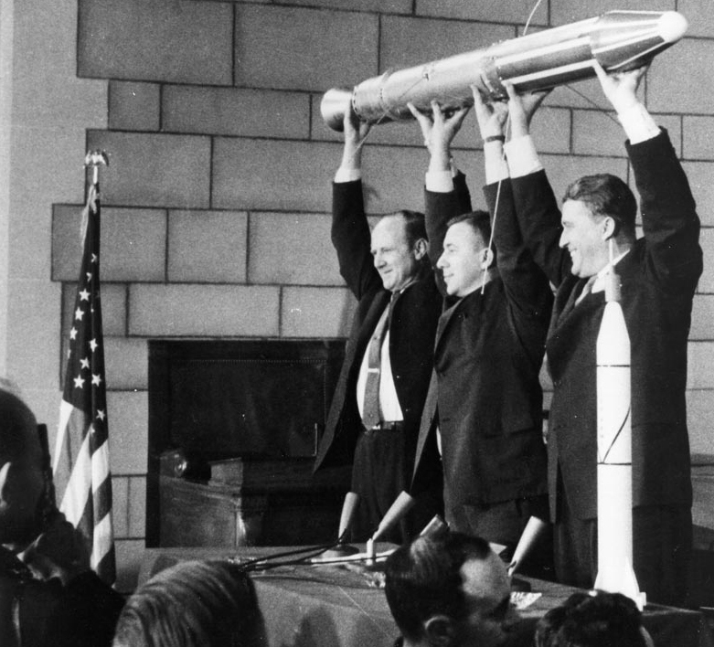 Pickering, Van Allen and Von Braun hold a model of Explorer 1 at a post-flight press conference.