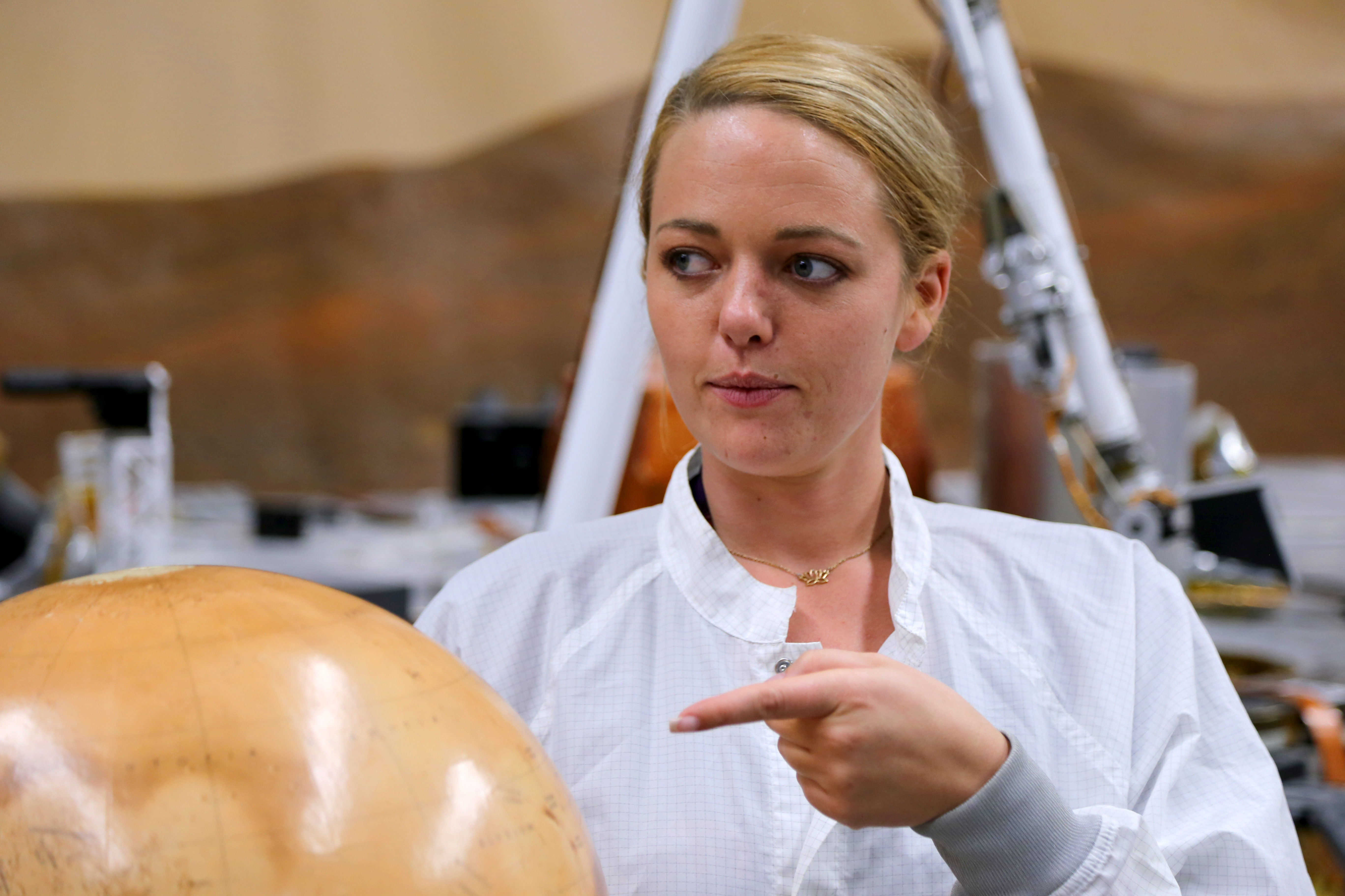 Heather Lethcoe points at a Mars globe