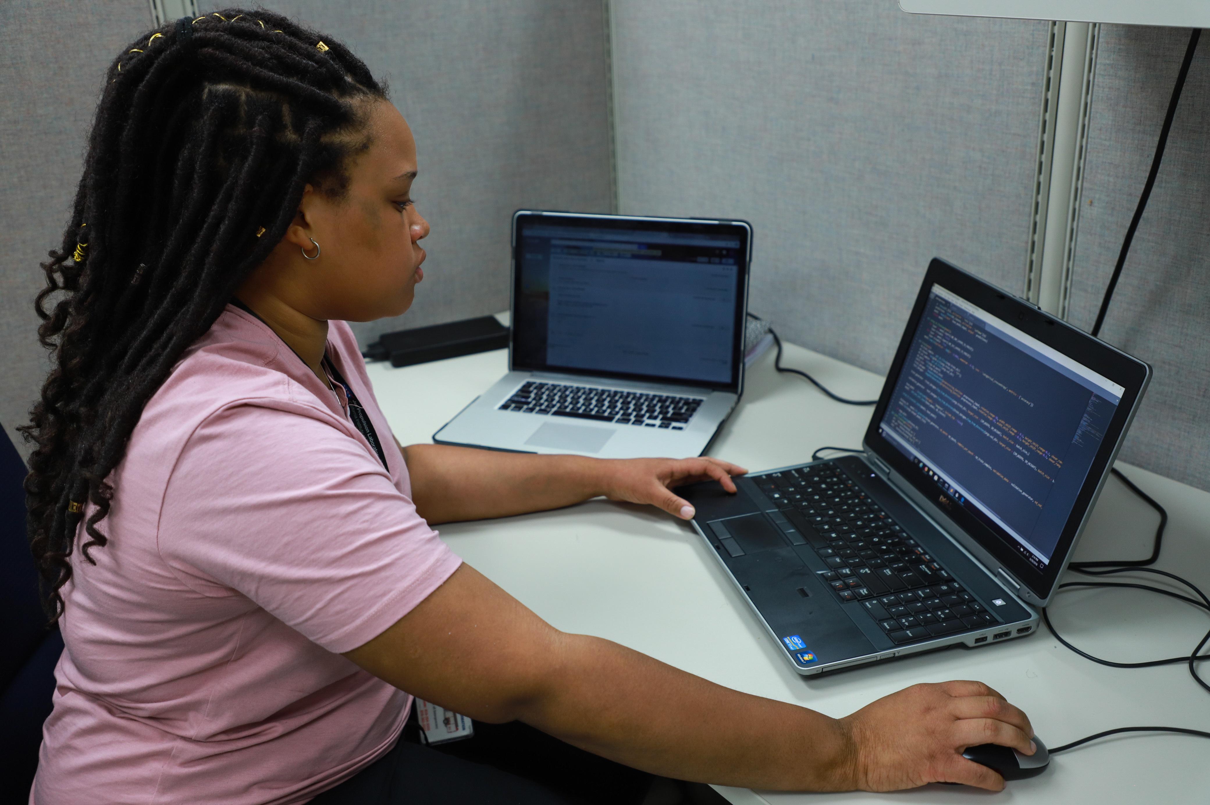 Jasmine Cameron sits at her computer at JPL