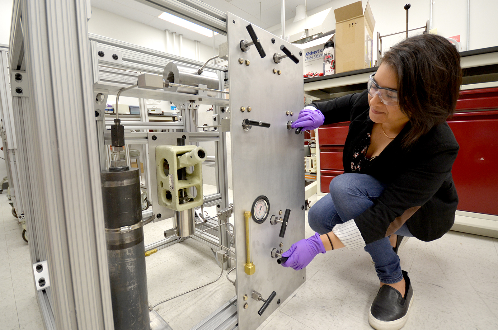 JPL intern Kathy Vega inspects the experiment she's helping create