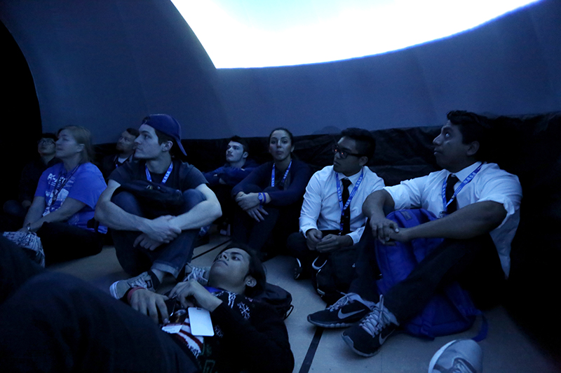NCAS students watch a show in the inflatable planetarium