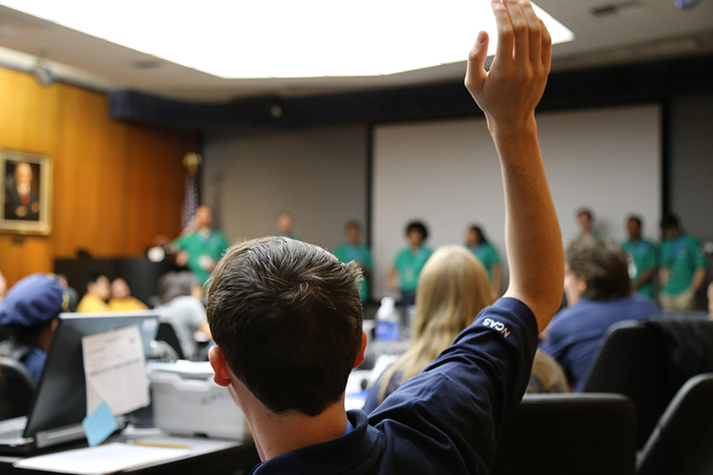 A student raises his hand to ask a question of the NCAS Green Team