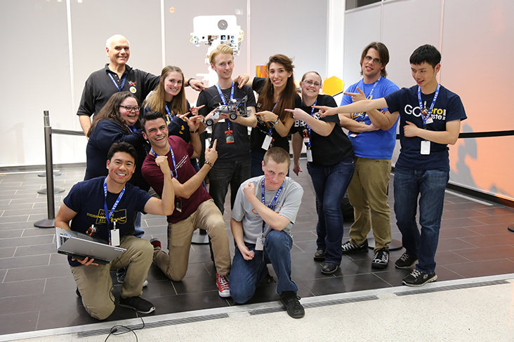 The Red Team poses for a group photo in front of the Mars Curiosity rover model at JPL