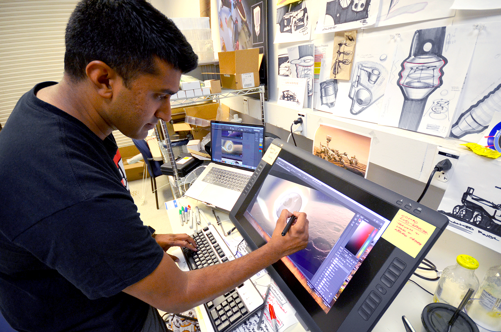 Omar Rehman works on an illustration at JPL