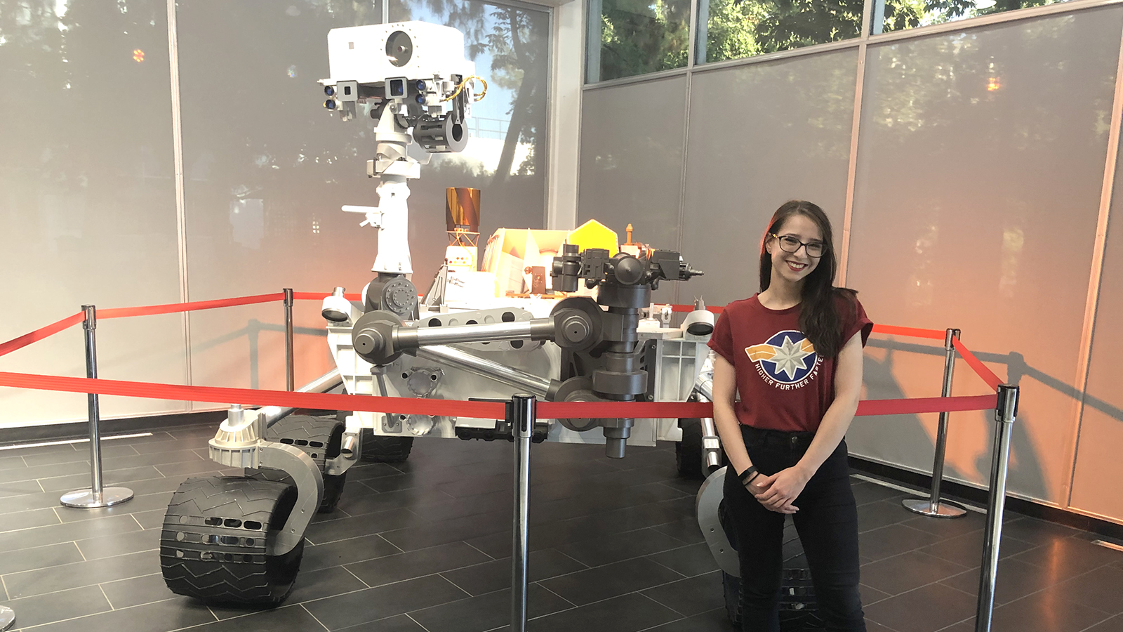 Radina Yanakieva poses in front of a model of the Curiosity Mars rover at JPL