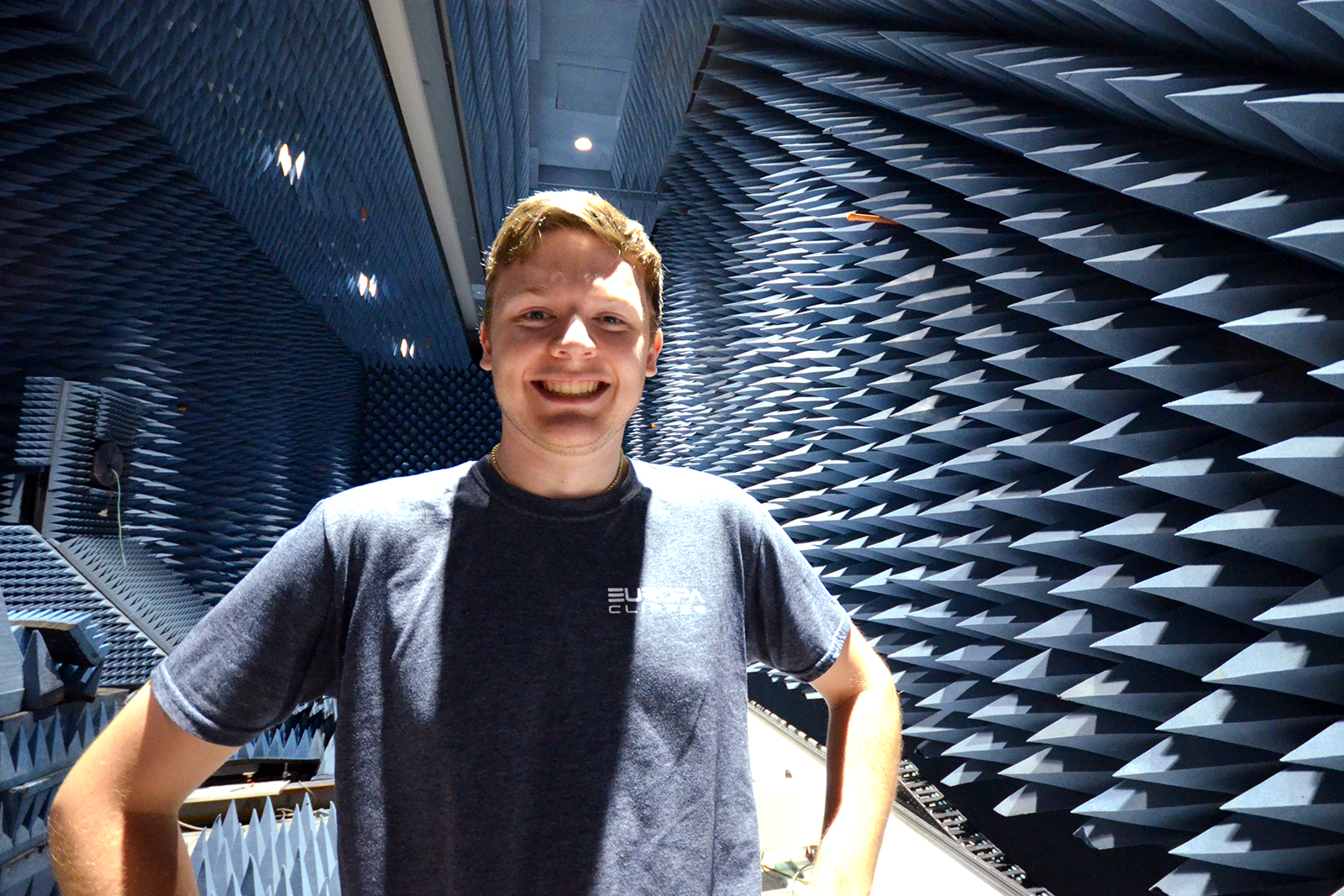 Zachary Luppen stands in an anechoic chamber at JPL