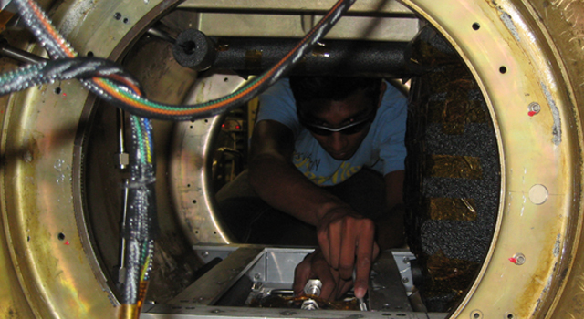 JPL intern Deepak Atyam works on the Environmental Control System for the Curiosity rover