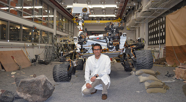 Payam Banazadeh poses with the Curiosity rover model