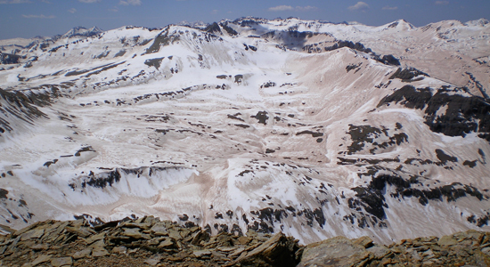 Snow melting on top of a mountainside