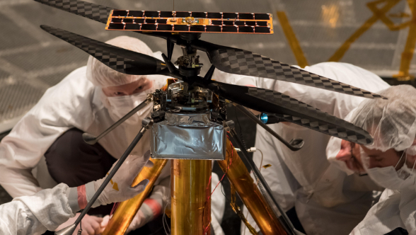 Engineers inspecting Mars helicopter Ingenuity