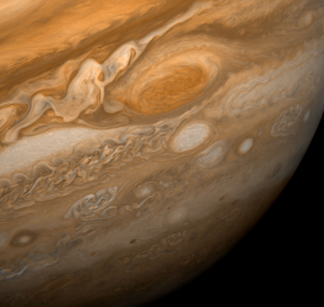 This dramatic view of Jupiter's Great Red Spot and its surroundings was obtained by NASA's Voyager 1 on Feb. 25, 1979. The colorful, wavy cloud pattern to the left of the Red Spot is a region of extraordinarily complex end variable wave motion.