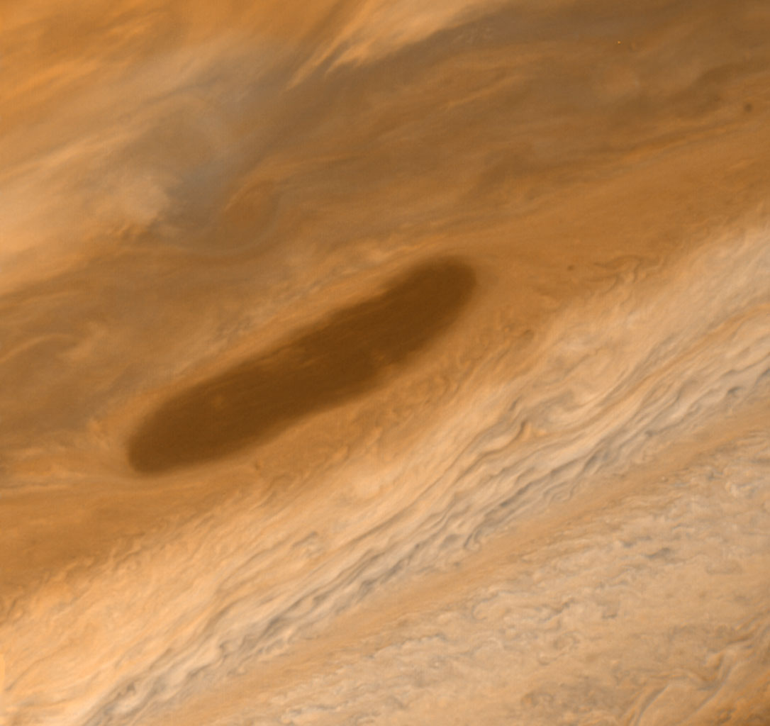 This large brown oval was photographed on Mar. 2, 1979 by NASA's Voyager 1. Features of this sort are not rare on Jupiter and have an average lifetime of one to two years. Above the feature is the pale orange North Temperate Belt.