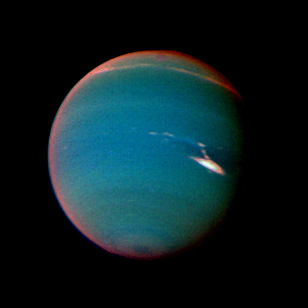 In this false color image of Neptune, objects that are deep in the atmosphere are blue, while those at higher altitudes are white. The image was taken by Voyager 2's wide-angle camera through an orange filter and two different methane filters.