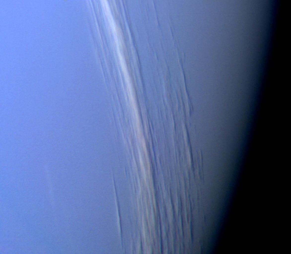 NASA's Voyager 2 captured this high resolution color image, taken 2 hours before closest approach, providing obvious evidence of vertical relief in Neptune's bright cloud streaks.