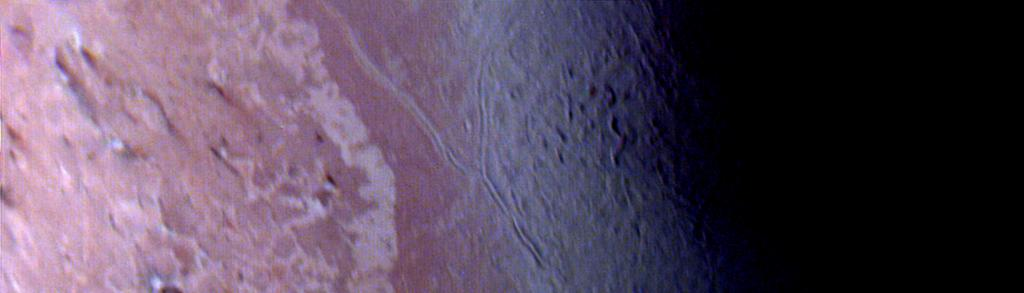 This image of the south polar terrain of Triton, taken NASA's Voyager 2 on Aug. 25, 1989 reveals about 50 dark plumes or 'wind streaks' on the icy surface.