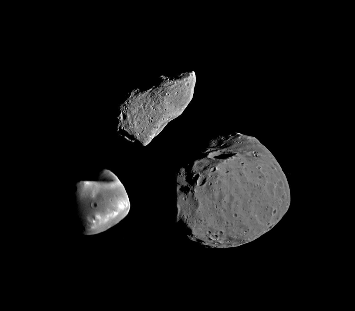 This montage shows asteroid 951 Gaspra (top) compared with Deimos (lower left) and Phobos (lower right), the moons of Mars.