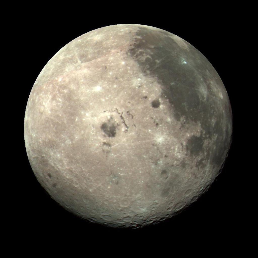 This color image of the Moon was taken by NASA's Galileo spacecraft at 9:35 a.m. PST Dec. 9, 1990, at a range of about 350,000 miles. The concentric, circular Orientale basin, is near the center; the nearside is to the right, the far side to the left.