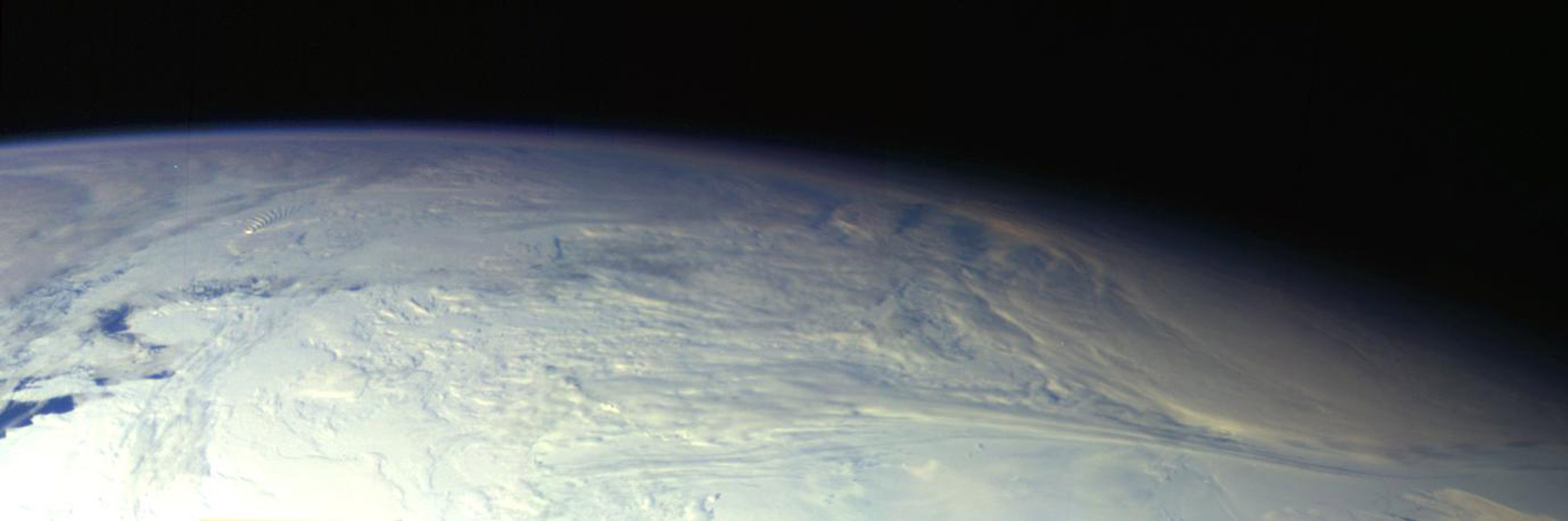 This color picture of the limb of the Earth, looking north past Antarctica, is a mosaic of 11 images taken during a ten-minute period near 5:45 p.m. PST Dec. 8, 1990, by NASA's Galileo's imaging system.