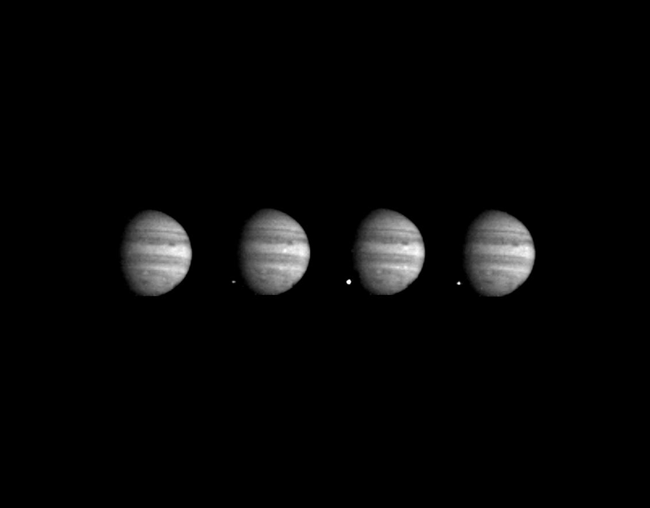 These four images of Jupiter and the luminous night-side impact of fragment W of Comet Shoemaker-Levy 9 were taken NASA's Galileo spacecraft on July 22, 1994.