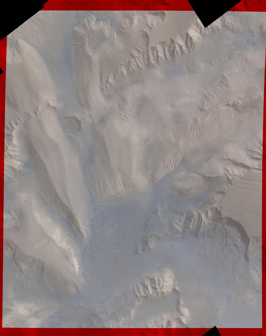 Part of Candor Chasm in Valles Marineris, Mars. Layered terrain is visible in the scene from NASA's Viking Orbiter 1., perhaps due to a huge ancient lake.