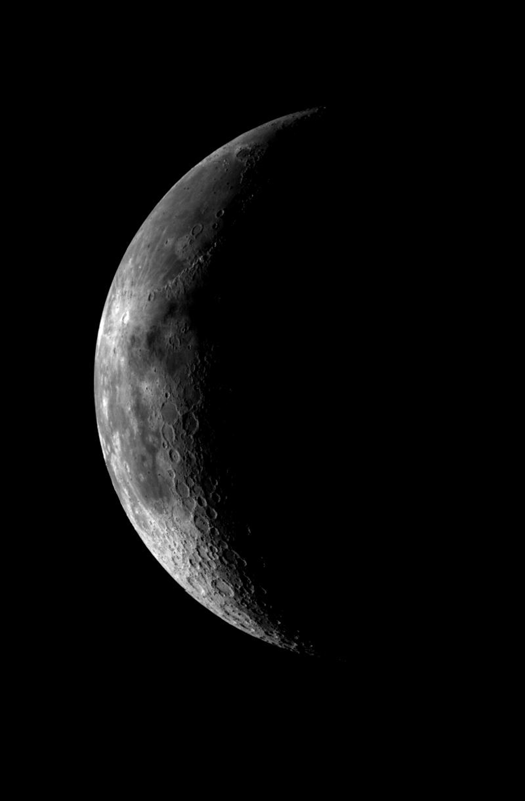 This image of the crescent moon was obtained by the Galileo Solid State imaging system on December 8, 1995 at 5 a.m. PST as NASA's Galileo spacecraft neared the Earth.