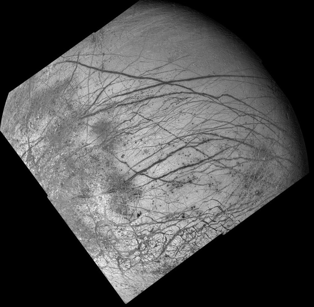 Dark crisscrossing bands on Jupiter's moon Europa represent widespread disruption from fracturing and the possible eruption of gases and rocky material from the moon's interior in this four-frame mosaic of images from NASA's Galileo spacecraft.