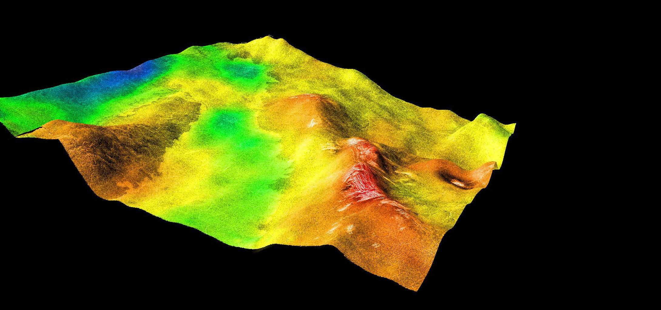 This perspective view of Venus, generated by computer from NASA's Magellan data and color-coded with emissivity, shows part of Sedna Planitia and illustrates a common phenomenon of the lowland plains of Venus.