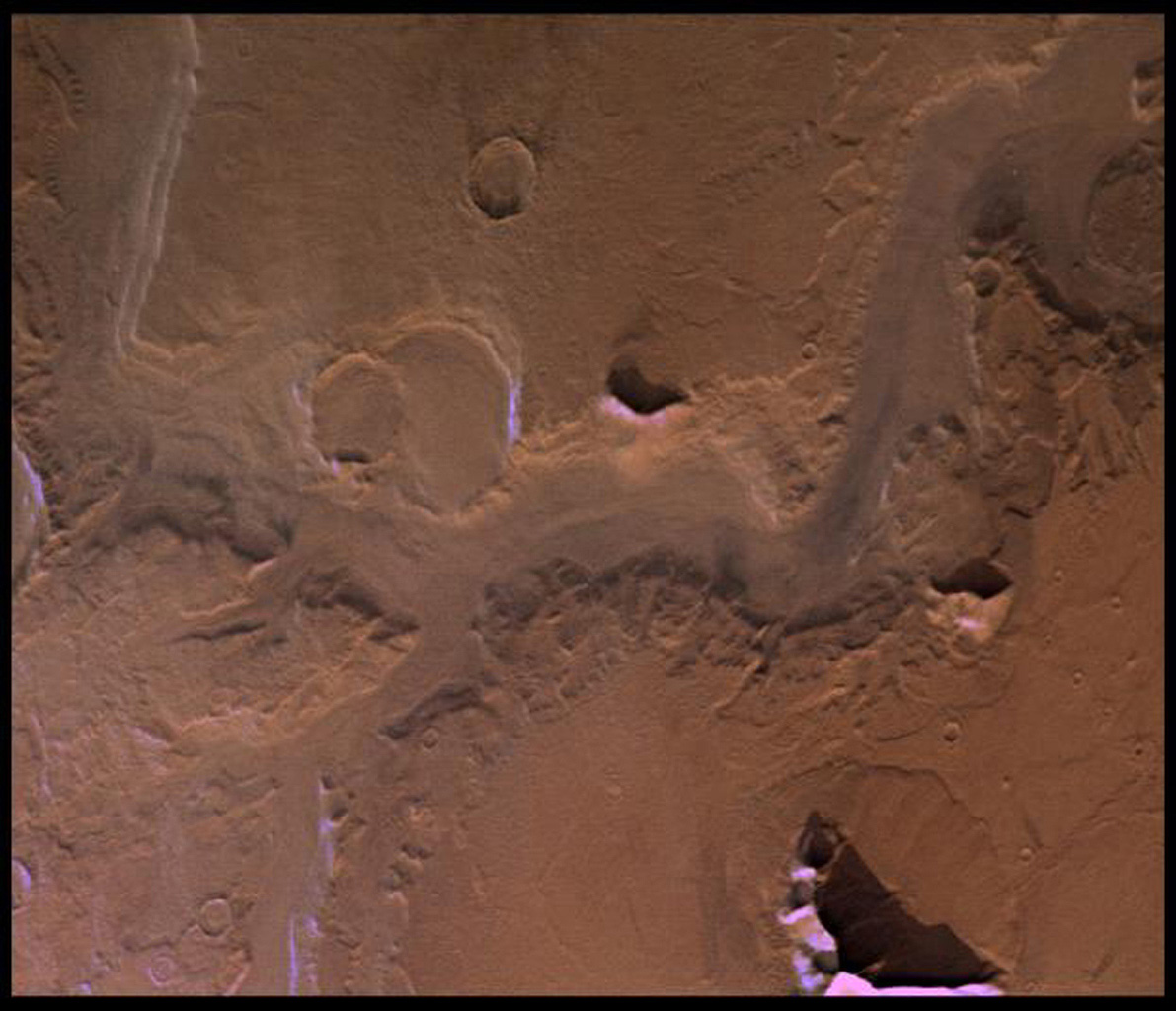 This image from NASA's Viking Orbiter 1 shows Reull Valles, a conspicuous southeast-trending fretted channel, dissects wall deposits of the large Hellas impact basin.
