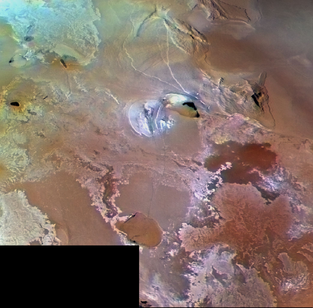 Io's volcanic plains are shown in this archival image from NASA's Voyager 1, which spans an area about 1030 km (640 miles) from left to right. Numerous volcanic calderas and lava flows are visible.