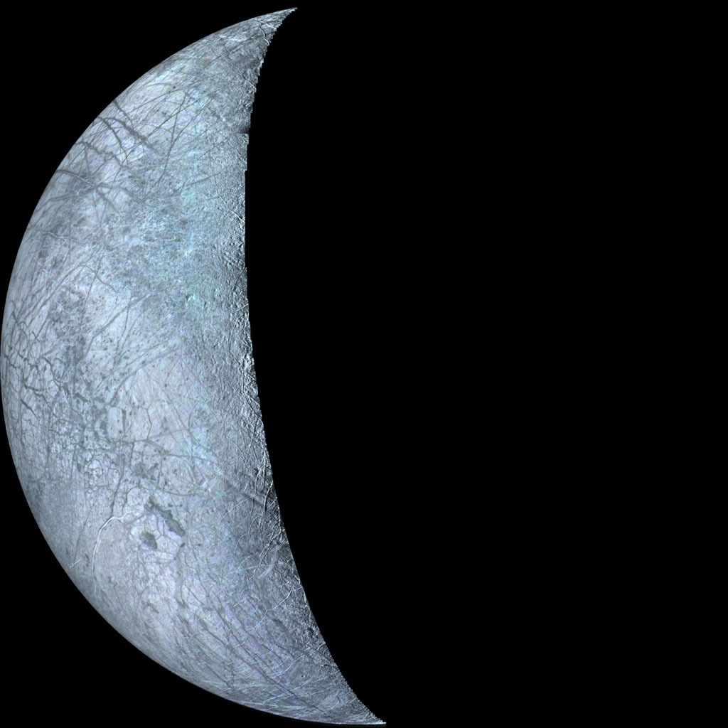This archival image taken by NASA's Voyager 2, is of Europa, the smallest Galilean satellite. The bright areas are probably ice deposits, whereas the darkened areas may be the rocky surface or areas with a more patchy distribution of ice.