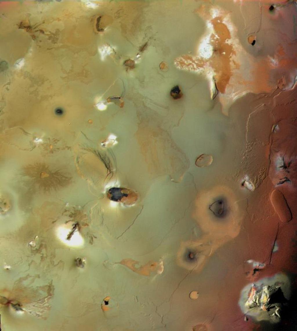 Io's volcanic plains are shown in this image from NASA's Voyager 1 taken in 1998. Also visible are numerous volcanic calderas and two large mountains (Euboea Montes, just above   center, and Haemus Montes, at lower left).