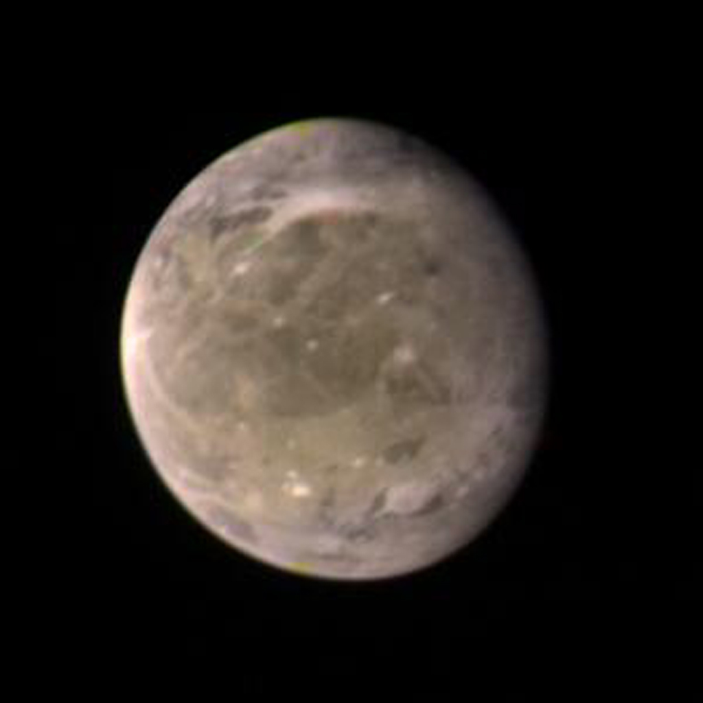 This color picture of Ganymede, Jupiter's largest satellite, was taken on the afternoon of March 2, 1979, by NASA's Voyager 1 from a distance of about 3.4 million kilometers (2.1 million miles).