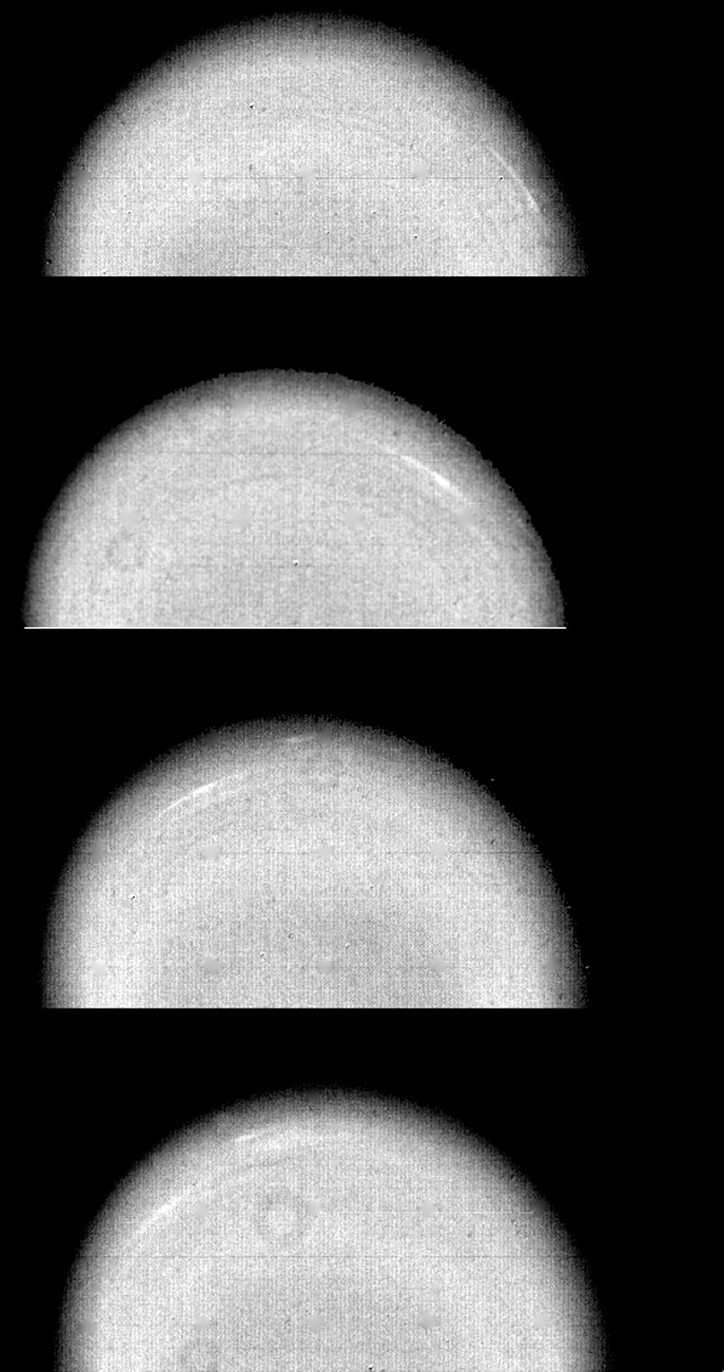 These time-lapse images of Uranus. taken by NASA's Voyager 2 on Jan. 14, 1986, show the movement of two small, bright, streaky clouds -- the first such features ever seen on the planet.