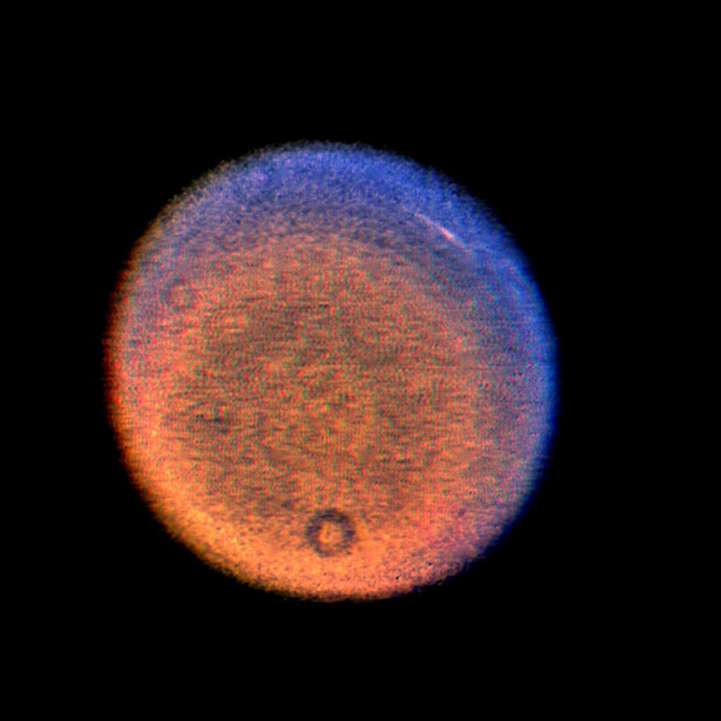 This false-color picture of Uranus, obtained by NASA's Voyager on Jan. 14, 1986, shows a discrete cloud seen as a bright streak near the planet's limb.