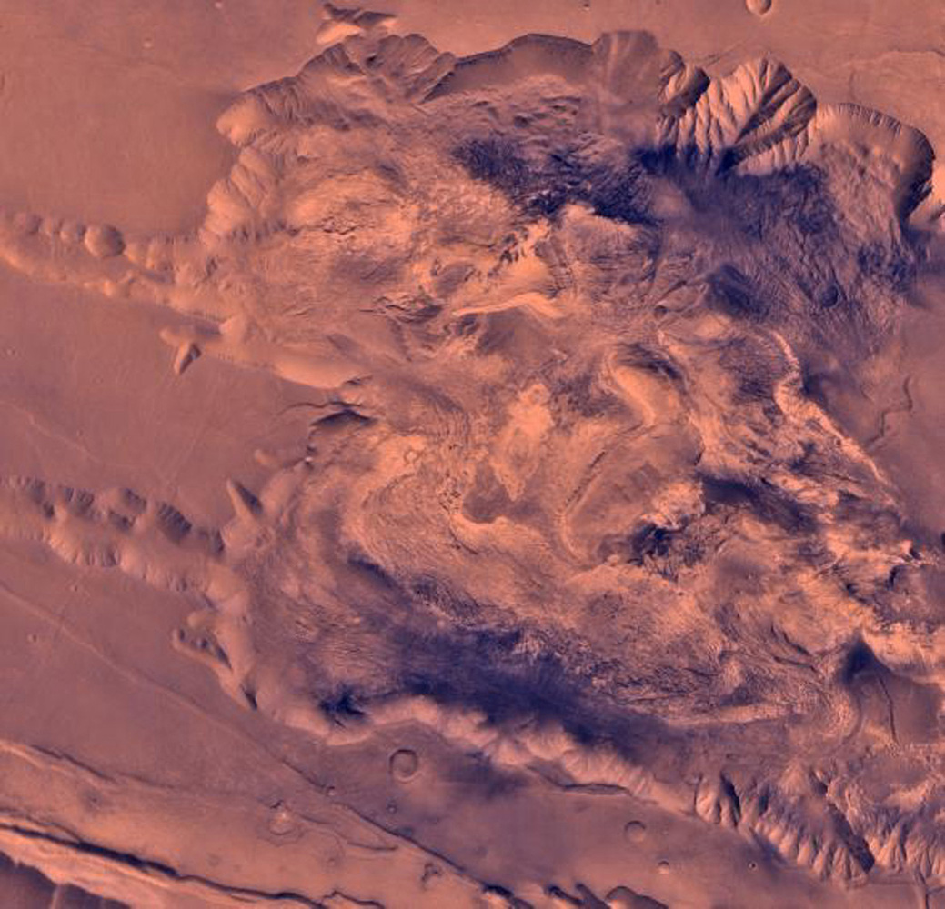 During its examination of Mars, NASA's Viking 1 spacecraft returned images of Valles Marineris, a huge canyon system 5,000 km long, up to 240 km wide, and 6.5 km deep. This view shows west Candor Chasm.