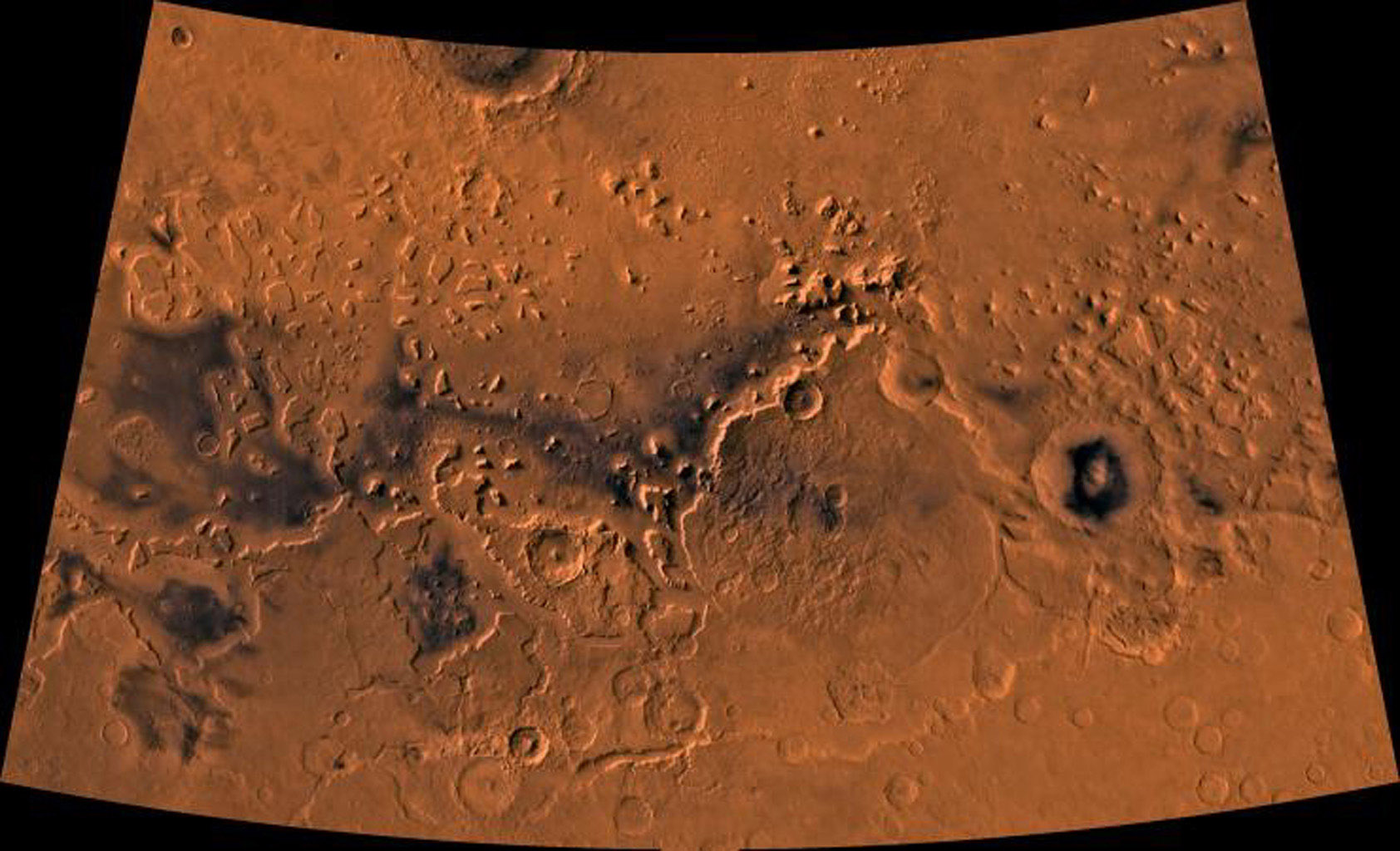 Ismenius Lacus region of Mars containing the impact crater Moreux. This scene shows heavily cratered highlands in the south on relatively smooth lowland plains in the north separated by a belt of dissected terrain, as seen by NASA's Viking spacecraft.