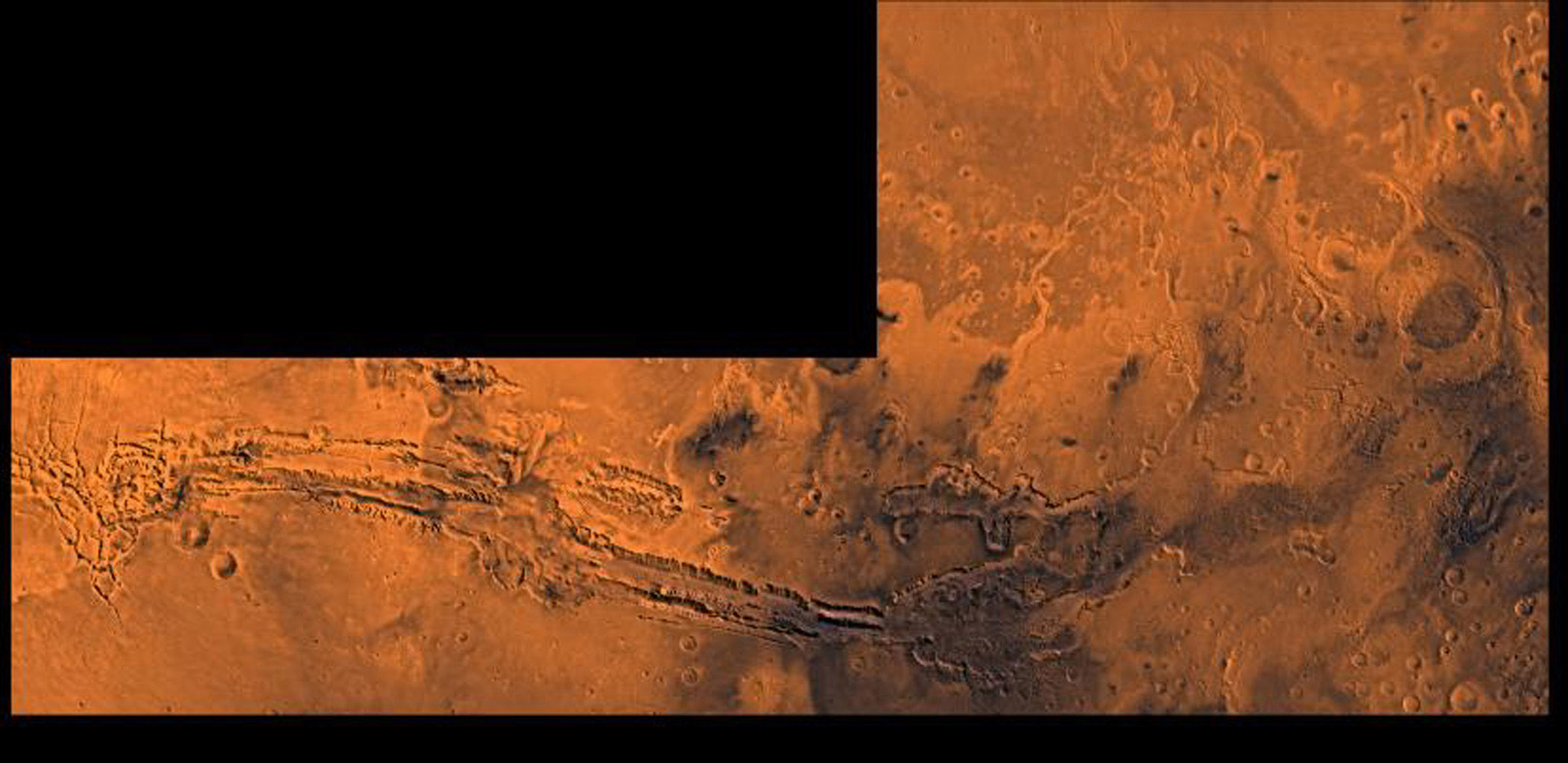 Valles Marineris, the great canyon and the south Chryse basin-Valles Marineris outflow channels of Mars. This scene shows the entire Valles Marineris canyon system extending from Noctis Labyrinthus, as seen by NASA's Viking spacecraft.