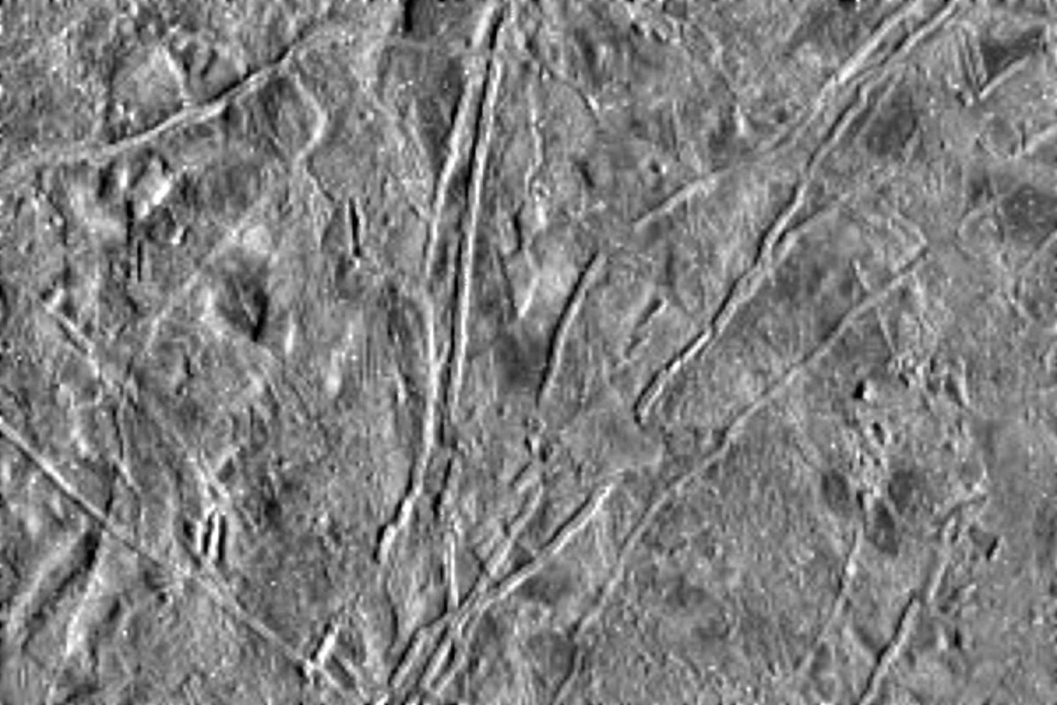 The icy surface of Europa, one of the moons of Jupiter, was photographed by NASA's Galileo spacecraft on its fourth orbit around Jupiter.