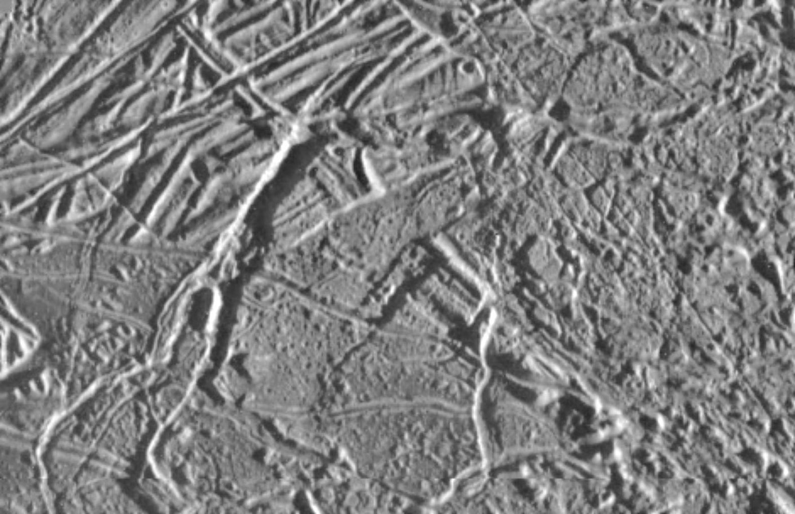 Jupiter's moon, Europa, is seen in this image taken by NASA's Galileo Orbiter. The smallest visible feature is about the size of a football field.