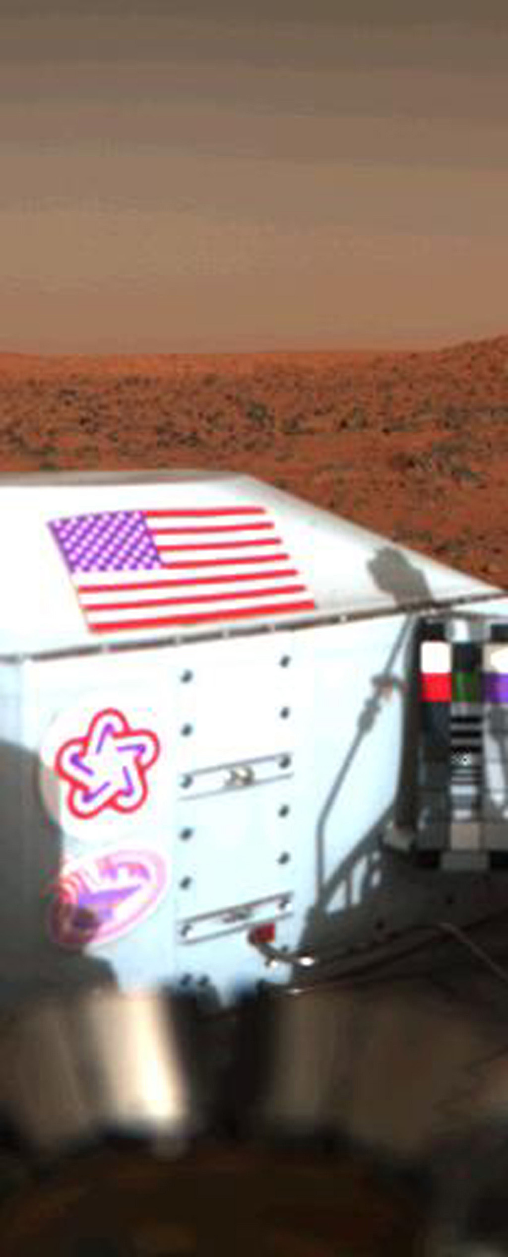 The flag of the United States with the rocky Martian surface in the background is seen in this color picture taken on the sixth day of NASA's Viking Lander 1 on Mars on July 26, 1997.